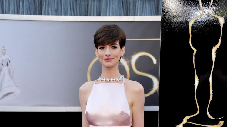 FILE - In this Feb. 24, 2013 file photo, actress Anne Hathaway arrives at the Oscars at the Dolby Theatre in Los Angeles. The Academy of Motion Picture Arts and Sciences announced Monday, March 25, 2013, that next year's Oscar ceremony will be held on March 2, 2014. The 2015 trophies will be handed out Feb. 22. (Photo by John Shearer/Invision/AP, File)