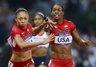 Allyson Felix takes the baton from team mate DeeDee Trotter in the women's 4x400m relay final (REUTERS)