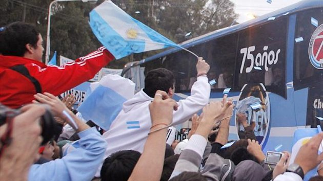 A bus carries the Argentine national team from training prior to the World Cup in 2010 (Reuters)