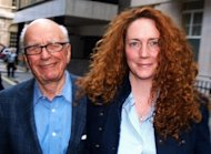 Rupert Murdoch (left), James Murdoch (not pictured) and Rebekah Brooks (right), who are all answering questions at parliament's Culture committee in London this afternoon