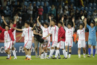 North Korea team members wave following the group C match between North Korea and Colombia at the Women's Soccer World Cup in Bochum, Germany, Wednesday, July 6, 2011. (AP Photo/Yves Logghe)