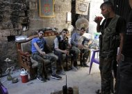 Free Syrian Army fighters rest as they drink tea in the old city of Aleppo September 10, 2013. REUTERS/Nour Kelze