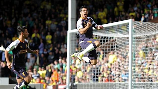 Liverpool's Luis Suarez celebrates scoring against Norwich