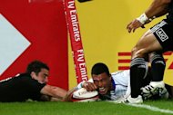 Samoa's Lio Lolo (R) scores a try despite New Zeland's Kurt Baker during their International Rugby Board Sevens World Series rugby union final match in Dubai. Samoa won 26-15