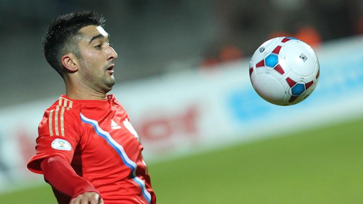 Russia's Alexander Samedov controls the ball during the World Cup 2014 Group F qualifying soccer match against Luxembourg, in Luxembourg city, at the Josy Barthel stadium, Friday, Oct. 11, 2013