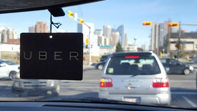 An Uber sign is seen inside a car in Calgary, Alta. (CBC)