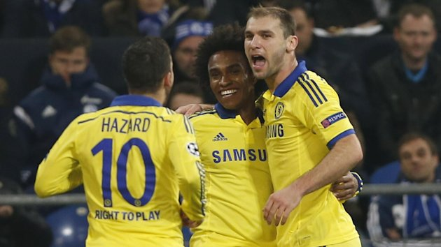 Chelsea's Willian celebrates with his team mates Eden Hazard (L) and Branislav Ivanovic (R) after scoring a goal against Schalke 04 (Reuters)