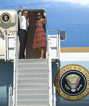 De rigueur sunglasses on, the president and first lady wave goodbye to the California desert after their June trip.