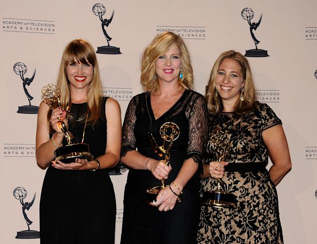 From left, Katia Blichfeld, Jennifer McNamara-Shroff and Jessica Daniels pose in the press room at the 2013 Primetime Creative Arts Emmy Awards, on Sunday, September 15, 2013 at Nokia Theatre L.A. Liv