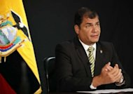 The United States has granted asylum to an Ecuadoran journalist critical of President Rafael Correa, seen here in August 2012, in what could be a subtle swipe at Quito over its sheltering of WikiLeaks founder Julian Assange