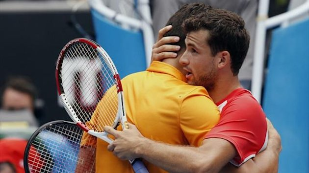 Grigor Dimitrov of Bulgaria hugs Milos Raonic of Canada (Reuters)