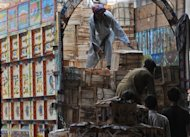 Pakistani men remove mango boxes from a truck at a vegetable market in Lahore in 2011. Pakistanis are abandoning much-publicised mango exports to the United States after just a year because American requirements made profit margins too narrow, members of the industry said Monday