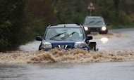 Weather: Travel Misery Amid Flood Warnings