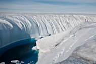 Meltwater creates a 60-foot deep (18.2 meter) canyon in the polar ice sheet.