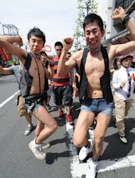 Gay people dance as they march on the street during the Tokyo Rainbow Pride 2012 in Tokyo. It was the first parade organised by Tokyo Rainbow Pride, a private organisation formed last year which aims to support the rights of sexual minorities