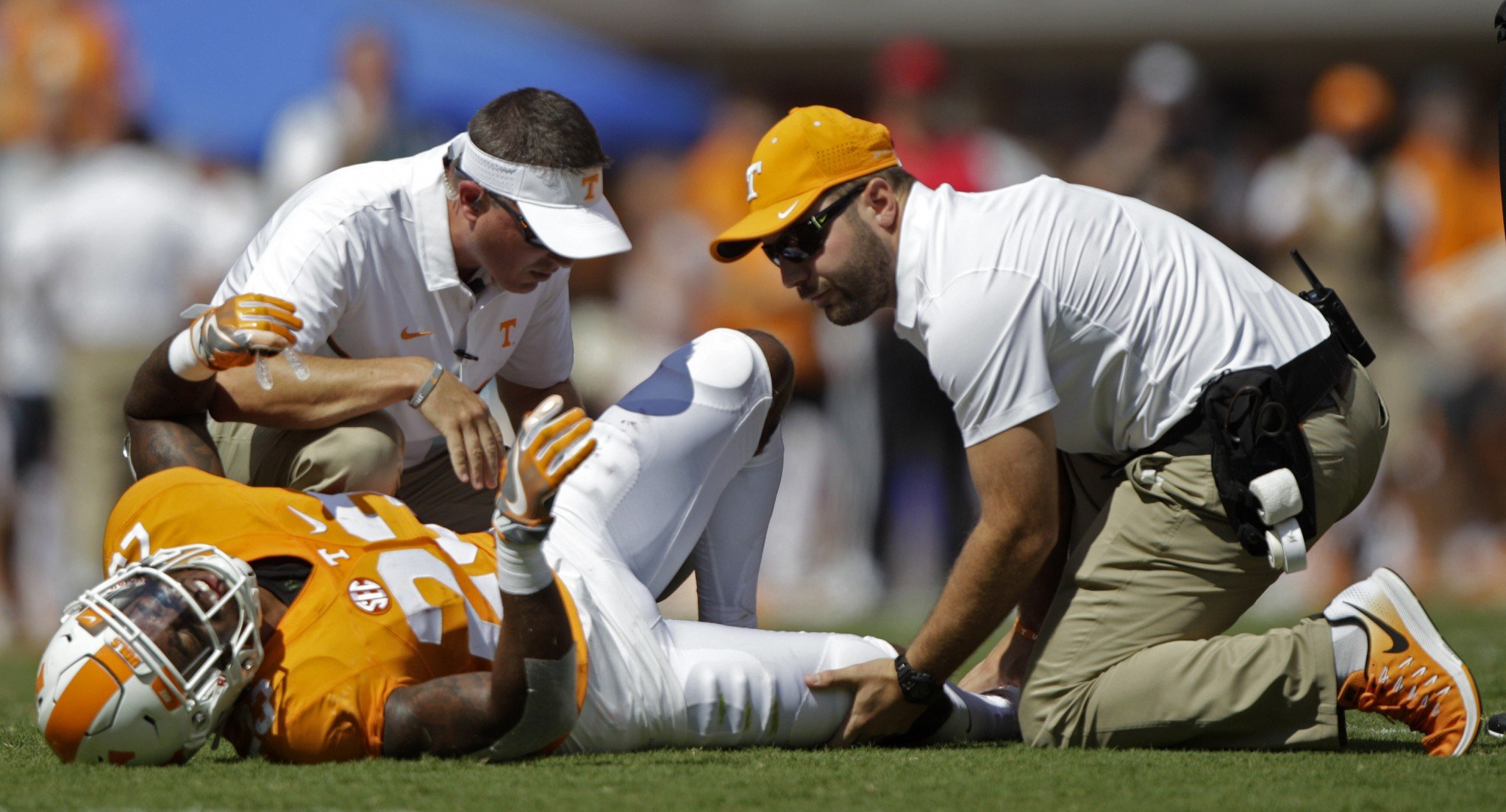 Tennessee defensive back Cameron Sutton (23) is attended to after being injured in the first half of an NCAA college football game against Ohio Saturday, Sept. 17, 2016, in Knoxville, Tenn. (AP)