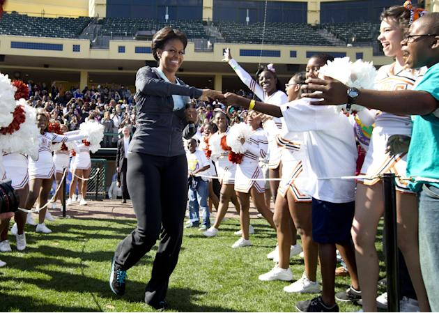 First lady Michelle Obama greets kids as she arrives for physical activity with kids at the ESPN Wide World of Sports Complex at the Walt Disney World Resort, Saturday, Feb. 11, 2012, in Orlando, Fla.