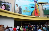 Cinema goers gather at a movie theatre in Dhaka. This month a bold new film by the country's best known novelist and filmmaker hit the screen, shedding light on the itinerant male Ghetus who would sing and dance wearing girls' attire and double up as bed partners for rich Muslims