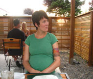 Pregnant woman in restaurant