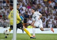 Real Madrid midfielder Mesut Ozil (R) scores past Mallorca goalkeeper Dudu Aouate during the La Liga football final against Mallorca on May 13. German international Ozil scored twice for Real