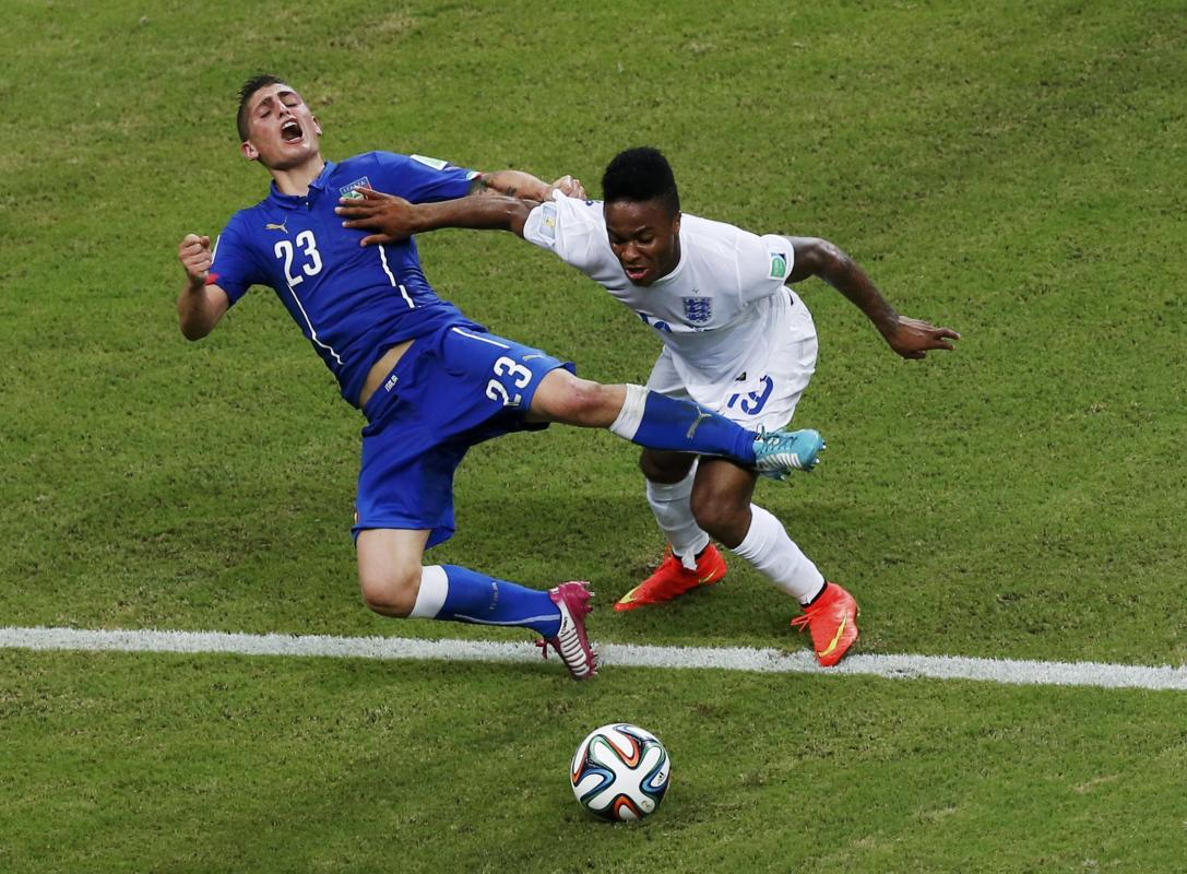 Italy's Verratti fights for the ball with England's Sterling during their 2014 World Cup Group D soccer match at the Amazonia arena in Manaus