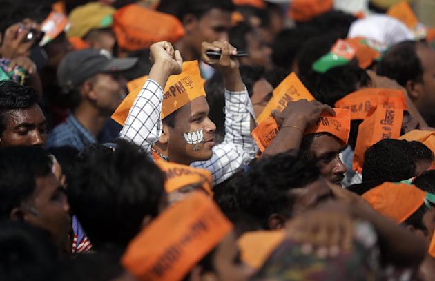 A supporter of India's main opposition Bharatiya Janata Party (BJP) sports a cutout of their party symbol on his face during an election campaign rally by prime ministerial candidate Narendra Modi