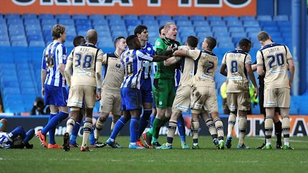 Matt Smith, right, was sent off against Sheffield Wednesday