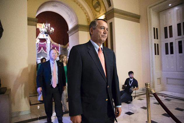 Speaker of the House John Boehner, R-Ohio, walks to the chamber as lawmakers vote to pay federal workers who have been furloughed during the government shutdown, at the Capitol in Washington, Saturday