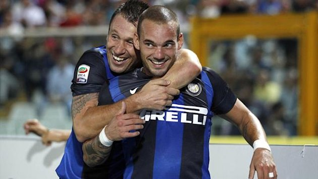 Inter Milan's Wesley Sneijder (R) celebrates with teammate Antonio Cassano after scoring against Pescara during their Italian Serie A soccer match at the Adriatico stadium in Pescara August 26, 2012 (Reuters)