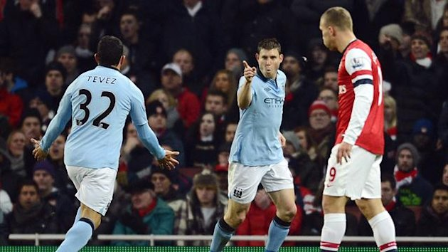 James Milner celebrates his opening goal for Manchester City against Arsenal