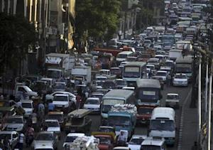 Cars are stuck in a traffic jam in downtown Cairo