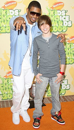 Justin Bieber with Usher in 2009. (Jason Merritt/Getty Images)