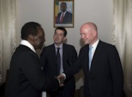 Malian President Dioncounda Traore (L) greets Britain's Foreign Secretary William Hague on March 4, 2013 in Bamako