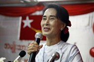 Myanmar opposition leader Aung San Suu Kyi delivers a speech at the National League for Democracy (NLD) headquarters in Yangon on September 27, 2013