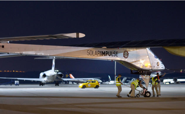 The Solar Impulse HB-SIA experimental aircraft is pulled out a hanger at Barajas airport in Madrid, Spain, Tuesday, June 5, 2012. The solar-powered airplane arrived in Madrid on May 25, 2012 from Paye