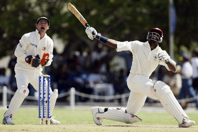 Chris Gayle of the University XI in action
