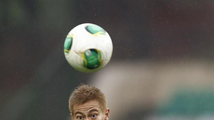 CSKA Moscow's Keisuke Honda controls a ball during a Russian Premier League Championship soccer match between CSKA Moscow and Terek Grozny at a stadium in Moscow, Russia, Sunday, Nov. 10, 2013