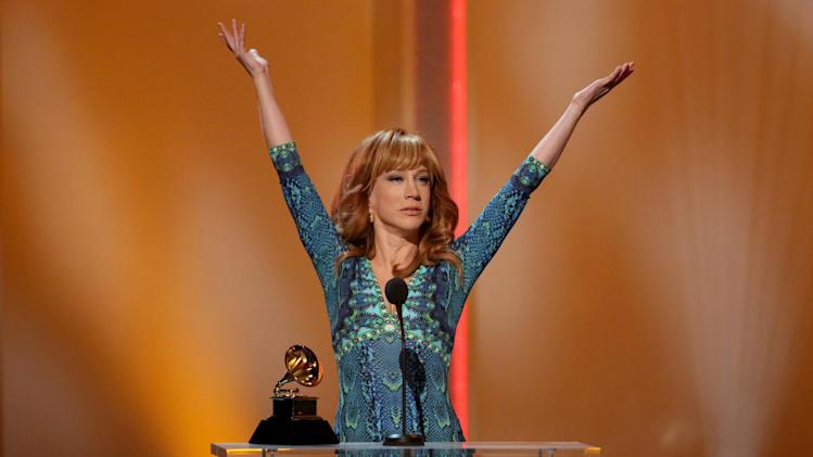 "Kathy Griffin accepts the best comedy album award for ""Calm Down Gurrl"" at the pre-telecast of the 56th annual GRAMMY Awards on Sunday, Jan. 26, 2014, in Los Angeles. (Photo by Matt Sayles/Invision/AP)"