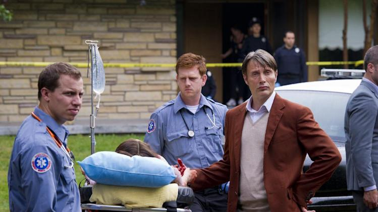 "This TV image released by NBC shows Mads Mikkelsen as Dr. Hannibal Lecter, right, in a scene from ""Hannibal,"" premiering Thursday, April 4, at 10 p.m. on NBC. (AP Photo/NBC, Brooke Palmer)"