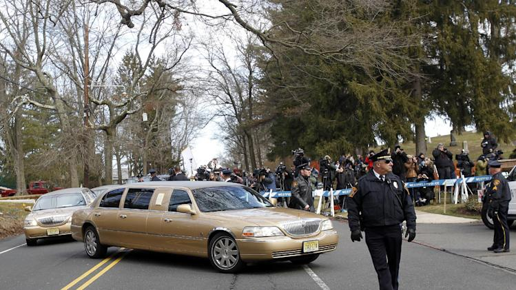 A long line of limos follow the hearse carrying the body of Whitney Houston arrives at Fairview Cemetery for her burial in Westfield, N.J., Sunday, Feb. 19, 2012. (AP Photo/Rich Schultz)