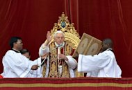 "Pope Benedict XVI delivers his traditional Christmas ""Urbi et Orbi"" blessing from the balcony of St. Peter's Basilica at the Vatican on December 25, 2012. The Pope called for an ""end to the bloodshed"" in Syria and denounced the ""savage"" violence in Africa on Tuesday, even as Nigeria witnessed a Christmas attack on Christians"