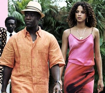 Don Cheadle and Noemie Lenoir in New Line Cinema's After the Sunset