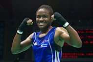 Nicola Adams of England gestures following her win against Elena Savelyeva of Russia during their flyweight semi-final bout at the Women's World Boxing Championships in China in May 2012. Her victory saved ensured she qualified for the Olympics
