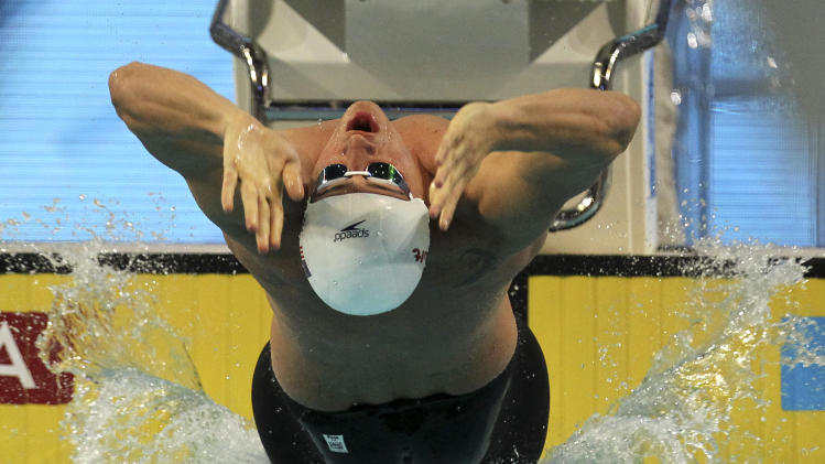 Ryan Lochte of the United States competes in the men's 200 meters backstroke heat during the FINA Short Course Swimming World Championships at the Sinan Erdem Arena in Istanbul, Turkey, Sunday, Dec. 16, 2012. (AP Photo/Thanassis Stavrakis)