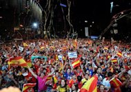 Supporters of the Spanish football team wave national flags in Madrid after their team defeated Italy 4-0 in the Euro 2012 football championships final. A red-and-yellow sea of delirious fans swamped central Madrid in a wild all-night party before hailing the return on Monday of their conquering Euro 2012 heroes