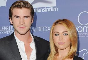Liam Hemsworth, Miley Cyrus | Photo Credits: Jon Kopaloff/FilmMagic