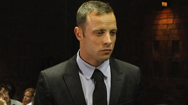Oscar Pistorius stands in the dock during a break in court proceedings at the Pretoria Magistrates court, February 20, 2013 (Reuters)