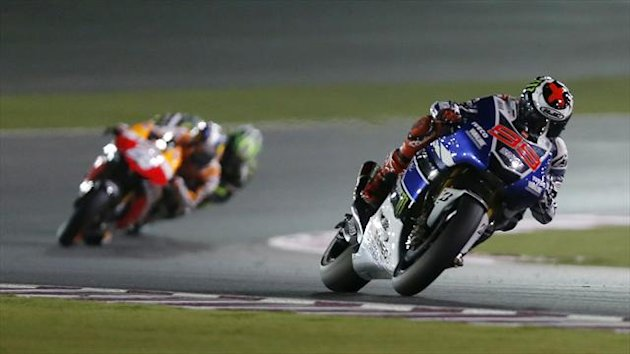 Yamaha MotoGP rider Jorge Lorenzo of Spain rides leading the pack during the Qatar MotoGP Grand Prix at the Losail International circuit in Doha (Reuters)