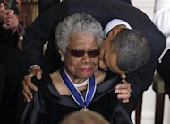 Maya Angelou receives a Medal of Freedom from U.S. President Barack Obama at the White House in Washington, February 15, 2011. REUTERS/Larry Downin/Files