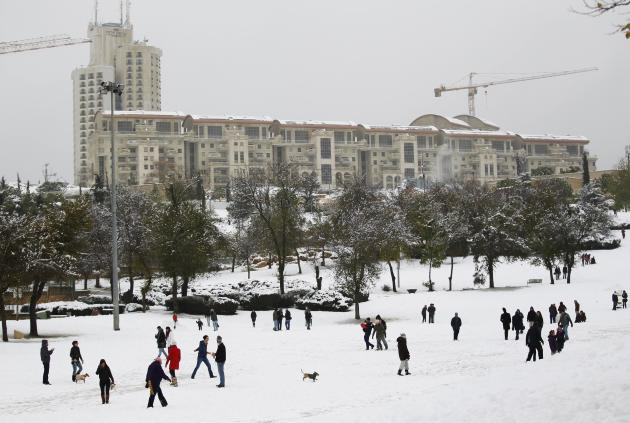 People visit a park after a snowstorm in Jerusalem